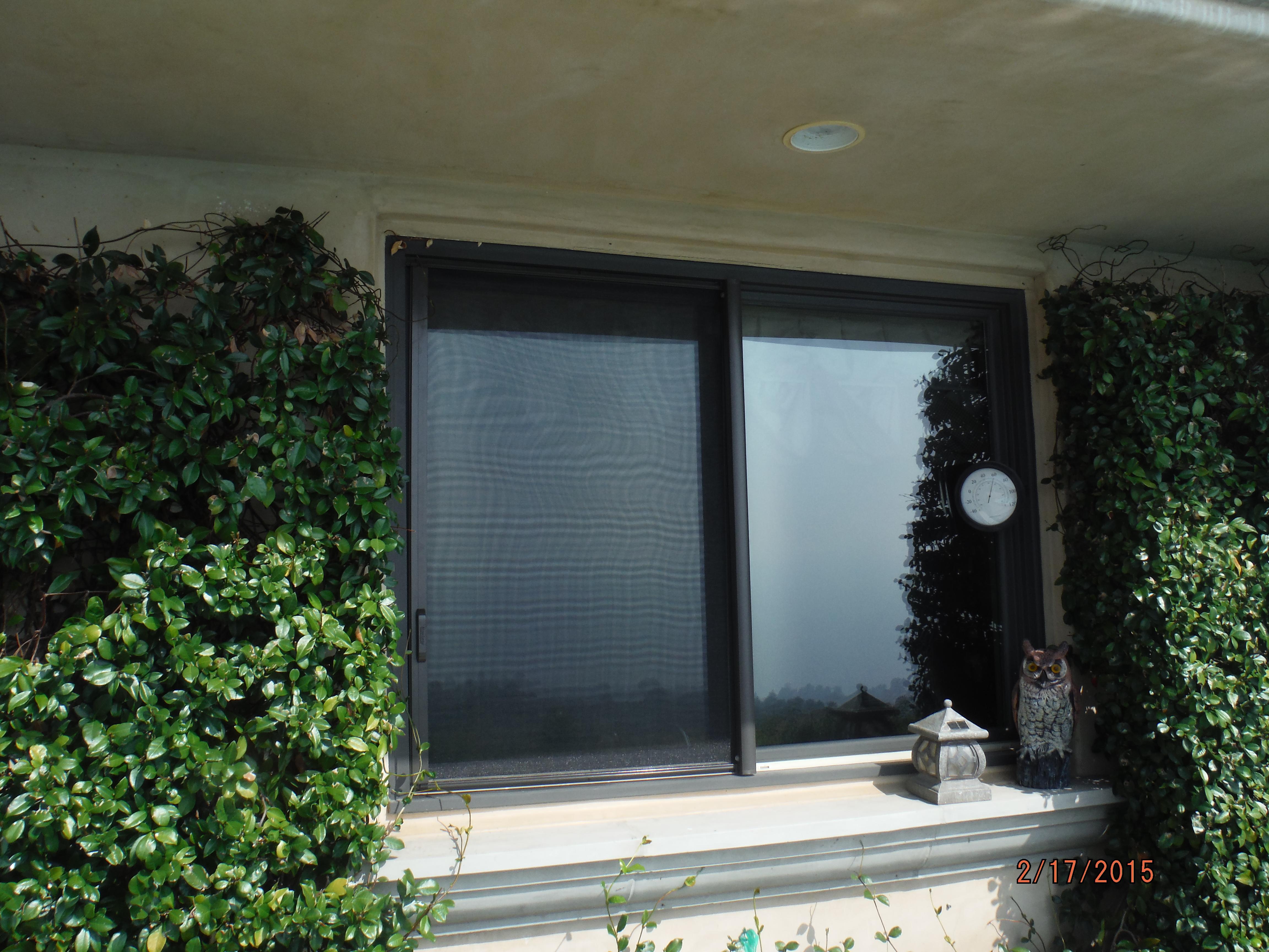 Retractable Screen Window for Kitchen Window in Malibu Home  