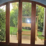 Double Set of Arched Screen Doors in Kitchen | Arched Retractable Screen Doors in Malibu