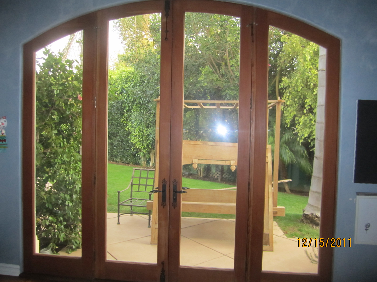 Double Set of Arched Screen Doors in Kitchen |