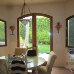 Double Set of Arched Screen Doors in Kitchen
