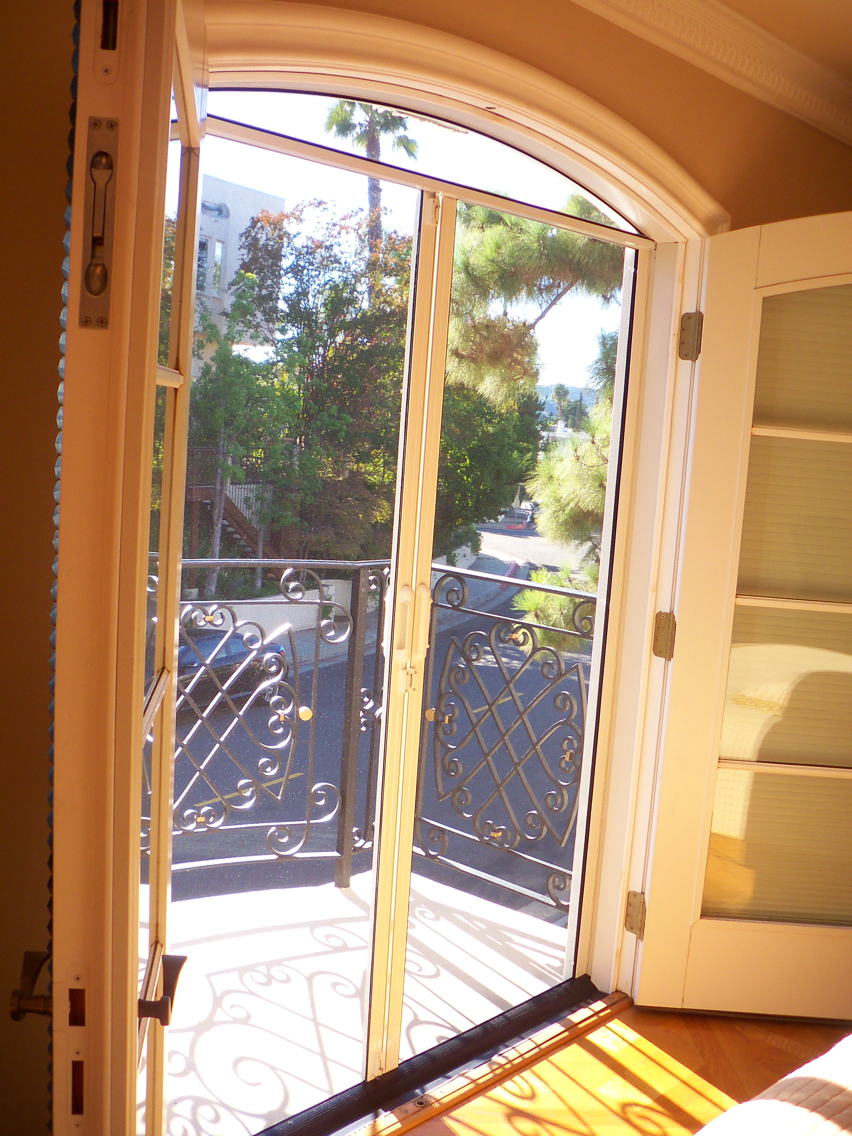 Double Set of Arched Screen Doors with Arched top Screen Header