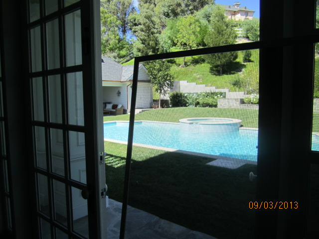 New window screens overlooking pool |