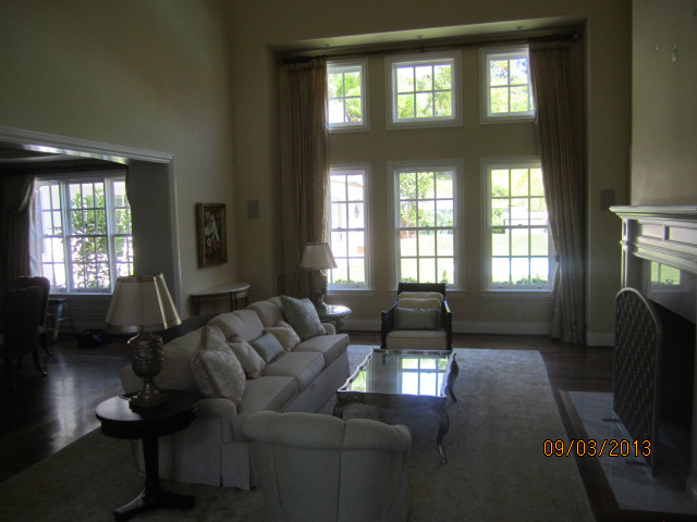 Large window screen panels installed in living room area |