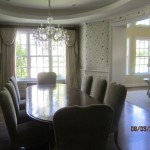 New window screens white frames and charcoal fiberglass screen mesh installed in dining room area