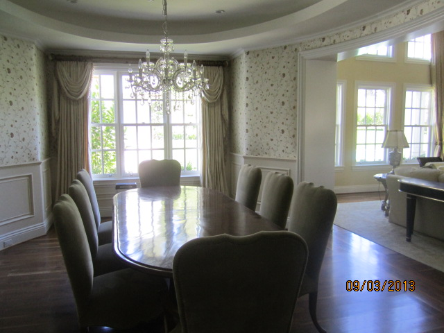 New window screens white frames and charcoal fiberglass screen mesh installed in dining room area |