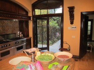 Retractable screen Doors installed on arched doors in kitchen