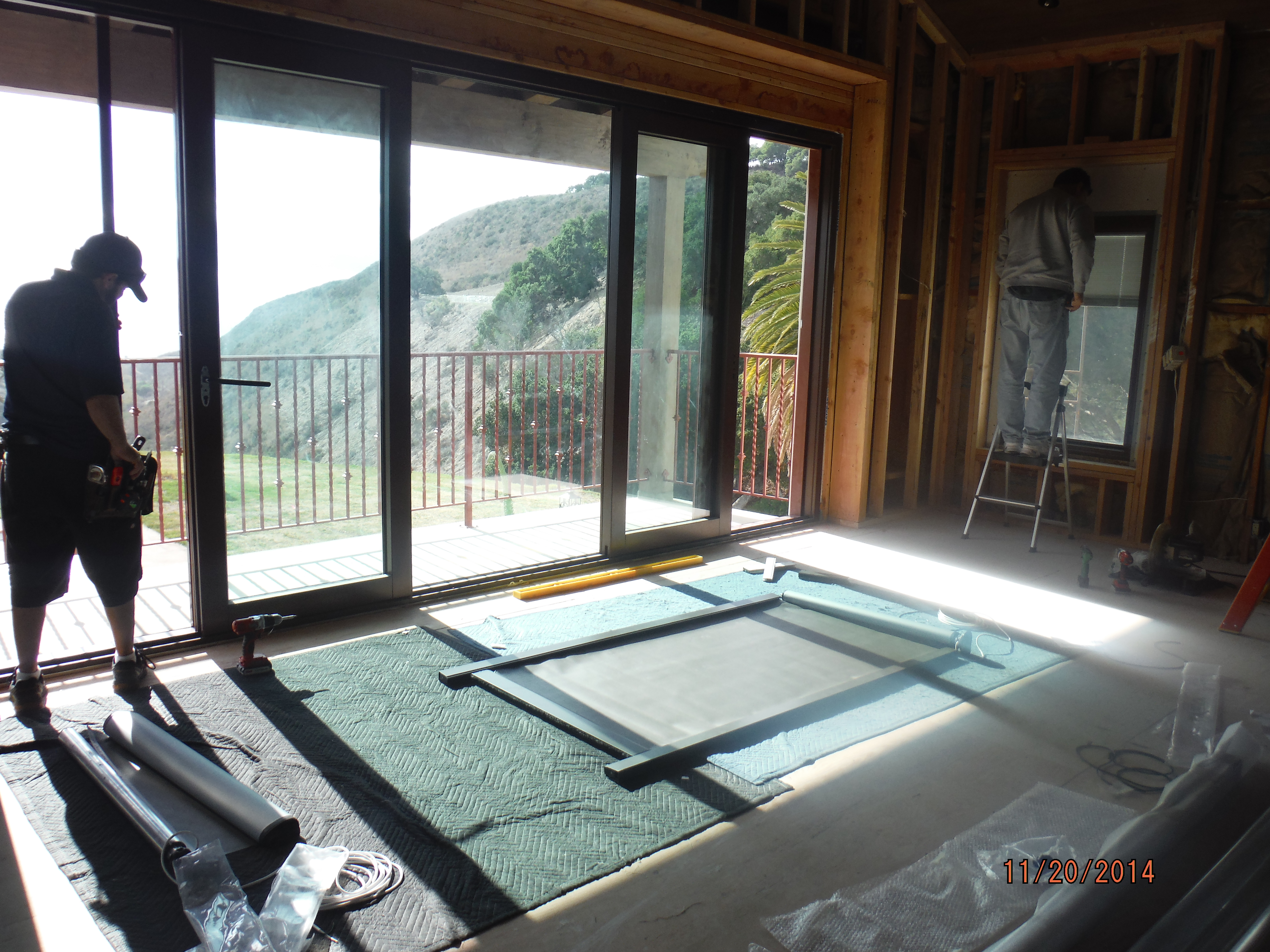 Installation Motorized Power Screens front view bi-folding doors