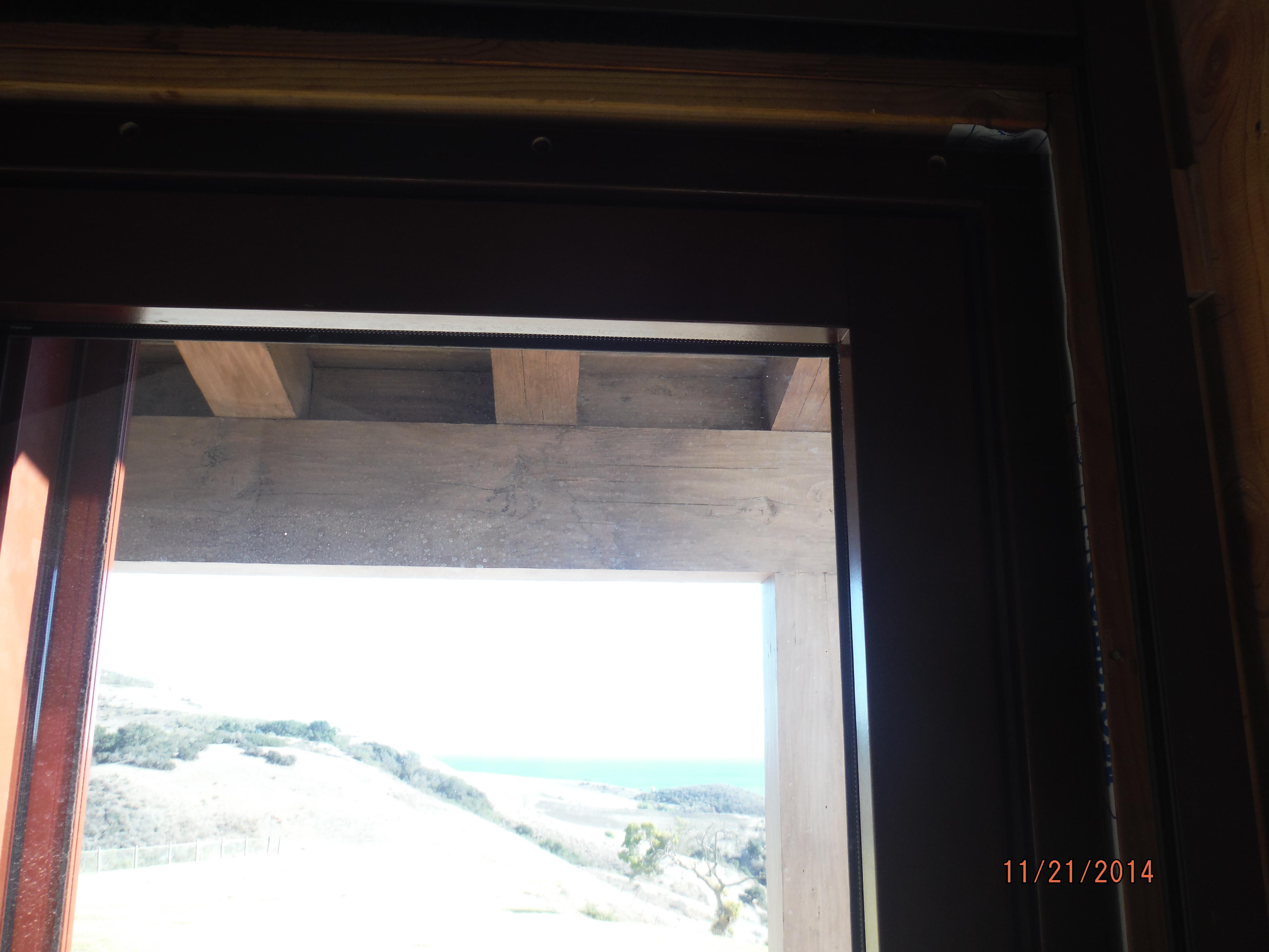 Installation Motorized Power Screens front view bi-folding windows in Santa Barbara in 2nd floor