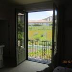 Open set of retractable screen doors in Topanga | Topanga Screens