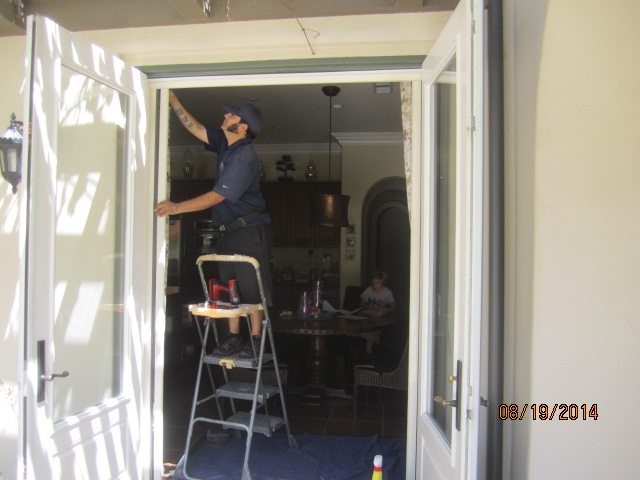 Double set retractable screen doors for French doors installed in Topanga |