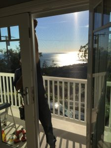 Malibu home arched window screen replacement balcony ocean view | Window Screen Repair in Malibu